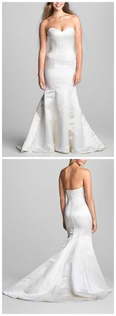 Absolutely stunning! Duchess silk trumpet wedding dress.