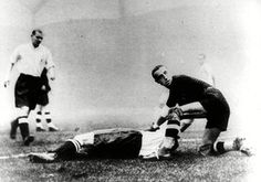 14 November 1934: Italy's goalkeeper Carlo Ceresoli helps an England player as he watches the ball go into the net during the 'Battle of Highbury'. With England refusing to take part in the World Cup, the visit of the 1934 winners was billed as a decider for the title of world's best. The game was brutal and full of incident; England went three up in 15 minutes before an <em>Azzurri</em> comeback. Despite England's 3-2 victory, an outraged home press demanded they withdraw from…