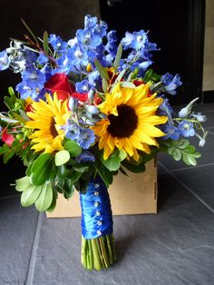 sunflowers, red roses and delphinium with a little bling on the handle Sunflower Bouquets, Blue Bouquet, Wedding Centerpieces, Wedding Bouquets, Budget Wedding, Wedding Ideas, Delphinium, Special Day, Floral Wedding