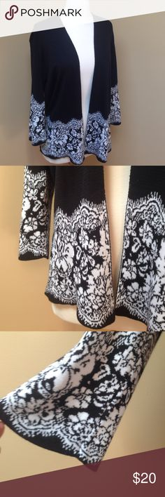 Christopher & Banks Cardigan Classic black and white cardigan. Looks great with a solid blue or pink/red camisole underneath. Beautiful sleeves and flower design.  Gently used. Christopher & Banks Sweaters Cardigans