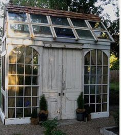 Garden glasshouse made entirely and cleverly out of recycled doors and windows