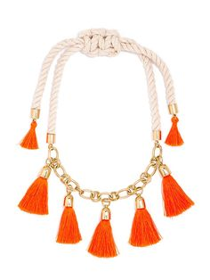 We love the contrast of natural rope with petite gilded links and fluorescent orange tassels for a statement that blends outdoorsy cool with on-trend fringe.