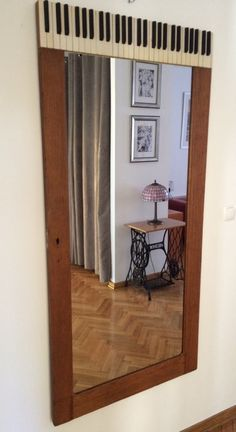 Vintage cabinet door turned to wall mirror decorated with old piano keys. I hope it looks expensive  - in fact very cheap
