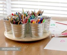 DIY art caddy - ordinarymom.ca Using a lazy susan and metal plant pots from Ikea- good idea.