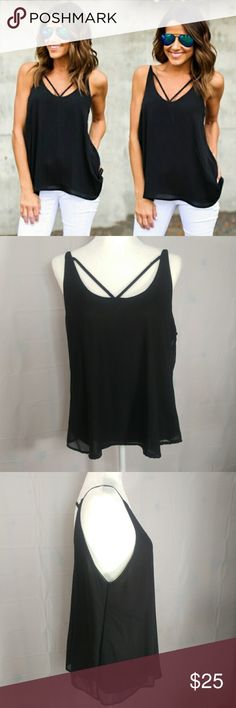 Cross Strap Spaghetti Tank Top XL-1X Black Flowy Tank top will fit a XL to a 1X depending on your chest size, please view measurements. Chest: 20 Shoulder: 12IN Top to Bottom (back): 18IN Top to Bottom (front): 18IN Bottom opening: 25IN Sleeve opening: 12IN Fabric:  POLYESTER BLEND. CROSS FRONT AND BACK SPAGHETTI. HAS A SILKY LINING WITH A SHEER OUTSIDE LAYER. NO Brand Tops Tank Tops