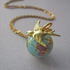 Winging My Way Back To You Globe Necklace
