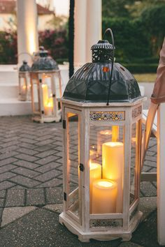Absolutely LOVE these enormous #lanterns with #candles inside. Nice touch! {Sam Gregory Photography}