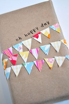 Mini bunting on Vintage wooden spool by acottagelife on Etsy, $12.00. You can make this decoration with string and washi tape for cheap gifts.
