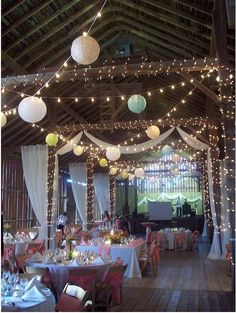 globe lights, lanterns, christmas lights, and drapery for barn wedding