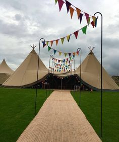 Two giant hat tipis with rainbow bunting walkway Inspiration for your tipi celebration. Wether you are looking for tipis for a wedding or party our gallery has plenty of ideas to help with your planning. Wedding Bunting, Carnival Wedding, Tipi Wedding, Marquee Wedding, Wedding Walkway, Wedding Entrance, Wedding Hire, Grand Entrance, Festival Themed Party