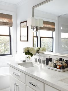 Notice the edge detail of the marble vanity countertop. Instead of the traditional edge detail that looks either rounded or molding-like, a more modern squared, block-like edge was chosen.