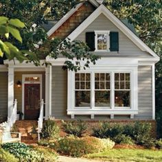 love the color with cream trim and dark shutters