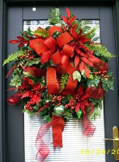 This XL door or wall wreath is gorgeous and full, and will make an outstanding statement on your door or over your fireplace. The velvet ribbon has
