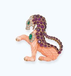 A PINK CORAL AND GEM-SET 'GRIFFIN' BROOCH, BY VAN CLEEF & ARPELS