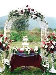 Indoor wedding arch decorations all includive wedding package think it would be better with sunflowers and fall colors indoor wedding archesfall junglespirit Choice Image