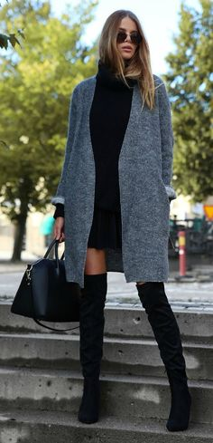 The over the knee boot trend continues this Fall. Pair it with a semi-long grey cardigan and a little black skirt and a matching knit jumper and you are good to go. Via Josefin Ekström  Coat: Vanessa Bruno, Skirt: Gina Tricot, Skirt: Vero Moda, Boots: Dinsko, Bag: Chiquelle