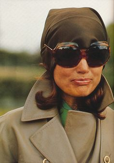 Jackie K. O.  --  LOVE this look! I'm totally going for it on cold, cloudy days when I'm outdoors. It sort of makes me think of a woman flying a plane back in the 20s without having to wear the little leathed cap and goggles. Just awesome. =)