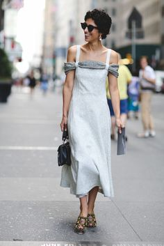 100+ Outfits We're Copying From The Streets Of New York City #refinery29  http://www.refinery29.com/2016/09/120553/nyfw-spring-2017-best-street-style-outfits#slide-58  Never underestimate a ladylike mididress. ...