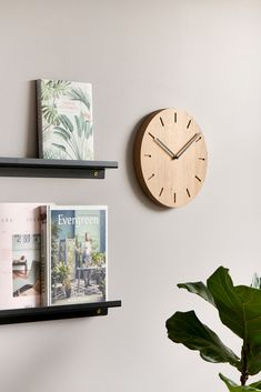 """The Watch: Out wall clock is made of solid oak and was designed by the Danish designer Anne Boysen, who was recently chosen as the winner of the TV show """"Denmark's Next Design Classic"""". Watch: Out is produced in family-run workshops in Denmark and is available in several timeless color combinations.⏱️💜 #danishdesign #localproduction #walldecoration #applicata #dänischesdesign #lokaleproduktion #wanddekoration Monochrome Fashion, Cata, Danish Design, Messing, Solid Oak, Minimalist Design, Scandinavian, Clock, Wall Decor"""