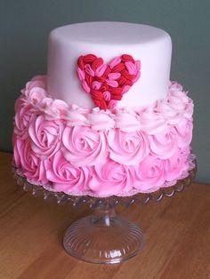 Inspired by: http://www.projectwedding.com/wedding-ideas/diy-ruffle-heart-cake/1  Bottom tier pink ombre buttercream, top red & pink ruffles