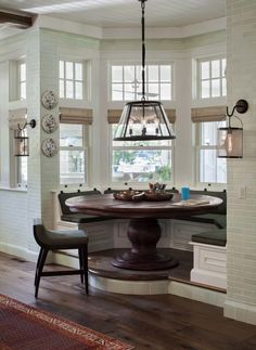 bay window dining room traditional small circular dining alcove is elevated for shipshape feel dining vignette design detail cottage traditionalneoclassical farmhouse by wade weissmann bay window nook breakfast drapes in and