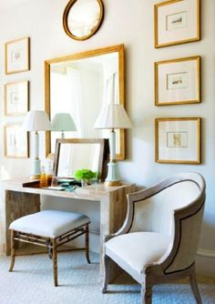 Foyer    Gold leaf picture frames photo gallery, gold leaf wall mirror, modern stone console table, faux bamboo bench stool ottoman with white upholstered cushion, blue turquoise buffet lamps and gray French accent chair! blue green wall paint colors.