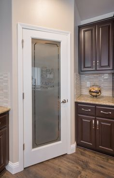 Frosted glass pantry door in kitchen design by Kathleen Jennison design