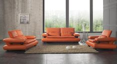 Good-Looking Orange Leather Sofas You Must Have : Fascinating Orange Leather Sofa with Durable Construction and Beige Rug also Black Tiles Flooring for Amusing Living Room Design
