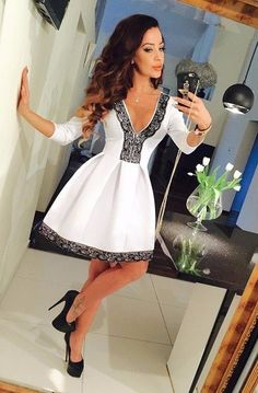- Elegant deep-v pattern cocktail mini dress for the modern fashionista - Trendy design offers a unique stylish look - Perfect for special occasions or parties - Made from high quality material - Available in 4 colors
