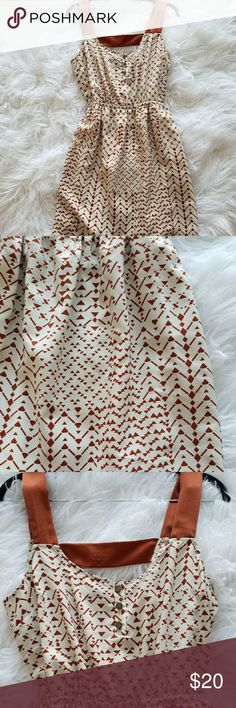 """Gorgeous Lush dress rust orange and cream colored Absolutely gorgeous Lush dress, size small. Euc! Rustic orange and cream colored geometric shapes.  Bust (armpit to armpit): 17.5"""" Length: 35""""  Material: 100% polyester Lush Dresses"""