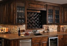 dark wood cupboards with brick stone