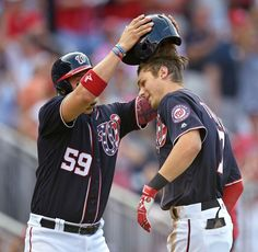 Helmet hair:     Trea Turner, right, celebrates his two-run home run with Washington Nationals teammate Jose Lobaton during the third inning against the Atlanta Braves at Nationals Park in Washington on Sept. 5. The Nationals won 6-4.