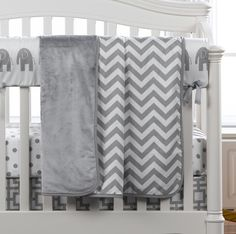 Gray Chevron Receiving Blanket | Liz and Roo Fine Baby Bedding. This blanket is adorable and modern for a gender neutral nursery. Coordinates with a gray elephants rail cover, gray and white polka dot crib sheet, and a Gigi crib skirt.