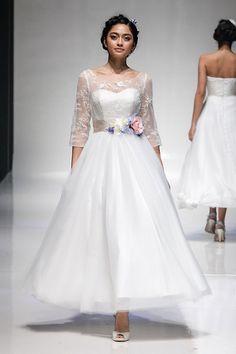 Floral #wedding dress ideas http://www.weddingandweddingflowers.co.uk/article/1124/15-stunning-floral-wedding-dresses