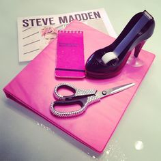 Totally girly! Got the stilleto tape dispenser all I need is to bling out my scissors! LOL!