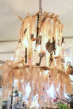 For inspiration:  A lamp shade make of junk.       Common Ground: A Visit to Robin's Vintage Suitcase
