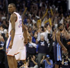 Oklahoma City's Kevin Durant (35) reacts after making the final basket during the NBA basketball game between the Denver Nuggets and the Okl...