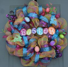 Wreath created by EverWreath  This is a very pretty and super colorful spring Easter wreath! Easter is really late this year (April 20th) so you can get a lot of use out of this beautiful wreath! It will brighten up your front door or an interior room in your home or office! It is made with Snapdragon deco mesh, RAZ Easter eggs, a RAZ Easter egg spray and a cute metal Easter sign all purchased from www.trendytree.com