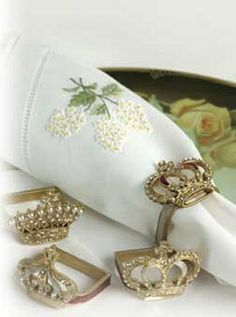 Regal Napkin Holders ~ Crowns with hand set crystals encompass rolled table linens.