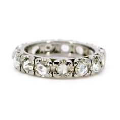 Binenbaum Antiques & Jewelry - This charming eternity Early Century (1910-1940) ring feature ±1,00ct. Rose Cut Diamonds crafted in White 18ct. Materials: Diamond, 18ct. Size: 17.53 NL / 55.1 FR / 7¼ US / O UK, not sizeable. Dimensions: 0,4 x 2,4 cm.. Weight in grams: 6.2. Condition: Good condition - used with some signs of wear.