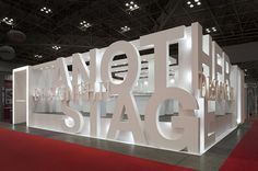 Creating stand wall boundaries from 3D lettering - great example of branding meeting practical architecture