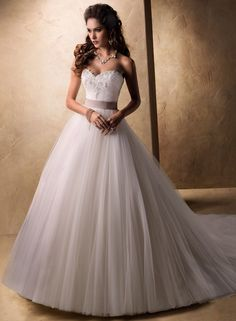 Smooth, clean lines with lace accent  {Maggie Sottero wedding gown}  ~~Get your custom wedding gown at www.theonecouture.com I would love this