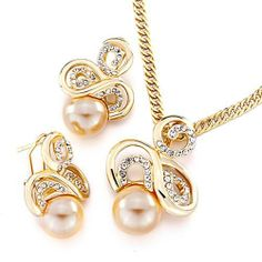Pugster Gold Swirl Clear Rhinestone Crystal Pearl Pendant Earrings Set Pugster. $24.99. Designed from Pearl element style. Free Chain in a matching metal will be included. Money-back Satisfaction Guarantee. Free Jewerly Box. Perfect gift for Christmas