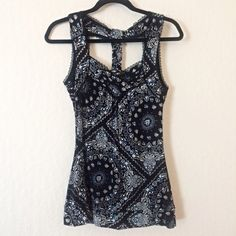 American Rag NWOT paisley-like print tank top This American Rag tank top is NWOT. The material is stretch and it has a T-strap style in the back. It is a blue, black, and white paisley-like print with lace detail as shown. Never worn before! Size medium. American Rag Tops Tank Tops