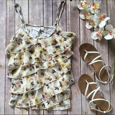I just discovered this while shopping on Poshmark: ❗️$10 SALE❗️ LC Lauren Conrad Floral Ruffle Tank. Check it out! Price: $10 Size: S
