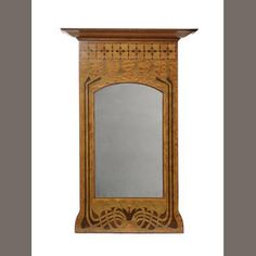 The Century Guild, attributed  An Art Nouveau Satinwood Inlaid Mirror, circa 1900