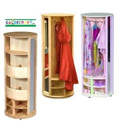 Dress-Up Carousel. Cleverly designed child-friendly storage unit features a hanging area with wooden pegs, storage cubbies, two mirrors, and storage bins for jewelry, scarves, hats and shoes.