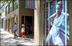 New Yorker's Craig and Michelle Goldstein walk out of the Cartier store in the Design District.