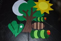 The Hungry Little Caterpillar Felt Story  A great way to keep children engaged in story telling. A great curriculum piece in preschool classes.  This felt story is 34 pieces in total.  You will receive:  1 tree 1 moon 1 sun 2 leafs (1 with the tiny egg on it AND one without that he eats through) 1 apple 2 pears 3 plums 4 strawberries 5 oranges 1 piece of cake 1 ice cream cone 1 pickle 1 slice of Swiss cheese 1 slice of salami 1 lollipop 1 piece of cherry pie 1 sausage 1 cupcake 1 slice of…