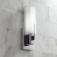 This transitional style white glass and chrome wall sconce is ideal for a bathroom or hallway. high x 4 wide. Extends from the wall. Backplate is 6 high x 4 wide. Uses one maximum 60 watt tube bulb (not included). Style # at Lamps Plus. Bronze Wall Sconce, Bathroom Wall Sconces, Modern Wall Sconces, Bathroom Light Fixtures, Led Wall Sconce, Bathroom Lighting, Master Bathroom, Basement Lighting, Hall Bathroom